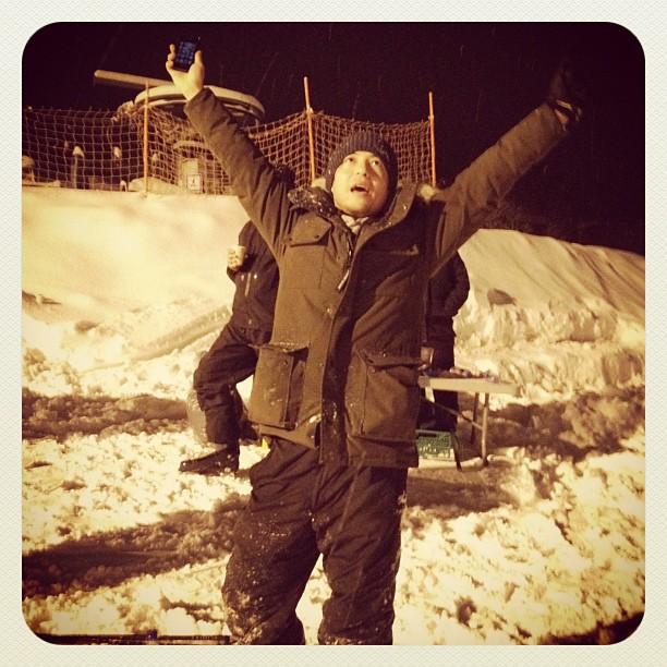 Producer having fun with wine on ski slope!