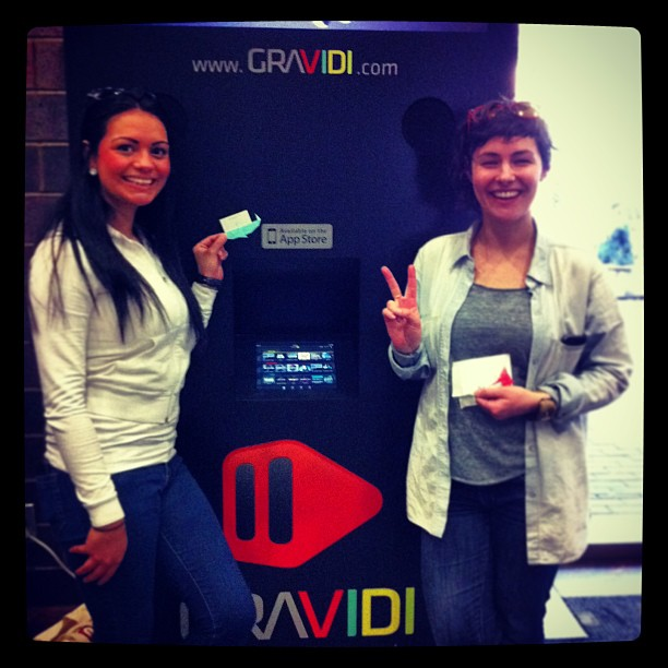 { #SXSW2013} Saw a news blurb on this 2 days ago, & spotted the booth by chance! On right~Claire, experience designer for【iPad app GRAVIDI】 (LA&NY), which lets viewers tap & make new discoveries during the film! 映像に出てくる物事についている目印をタップして、さらなる情報を観ることが出来るiPad用アプリ!→gravidi.com